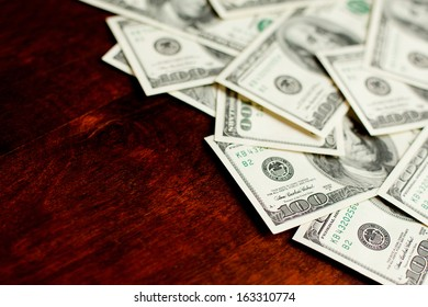 Background with money american hundred dollar bills on wooden desk