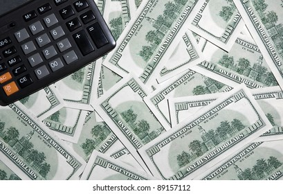 Background with money, american hundred dollar bonds and calculator