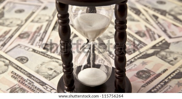 Background with money american hundred dollar and hourglass