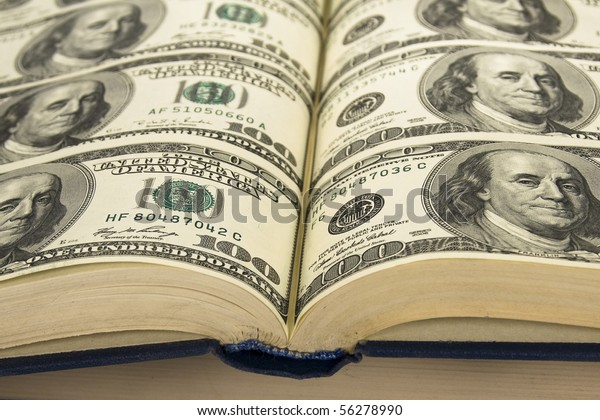 Background of Money in book. book with pages of dollars \ Dollars in  books