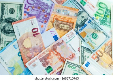 background of money. paper euros, rubles, and dollars. The concept of difference and uniformity of money. For financial journals and articles