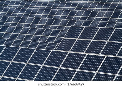 background of mono-crystalline photovoltaic modules in a solar power plant
