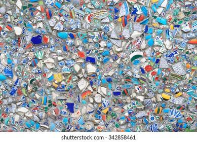 Background mosaic of broken tiles wall