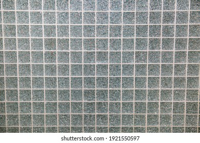 Background of mosaic glass silver mirror square shape glued with white seams Plumbing bathroom construction repair.