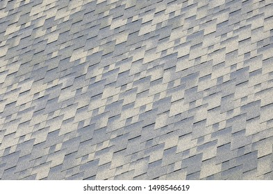 Background mosaic texture of flat roof tiles with bituminous coating