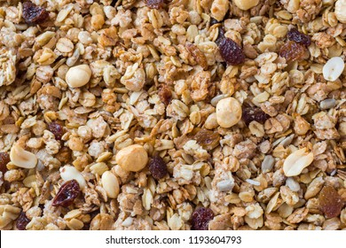 Background of Muesli Breakfast with oat flakes raisins. Close-up view of the crispy granules. The concept of Healthy eating