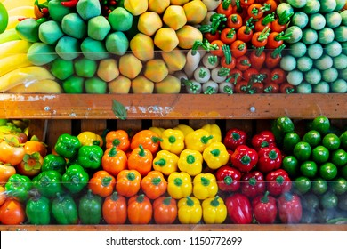 Background of multi colored assortment artificial fruits and vegetables.