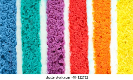 Background of multicolor six layer cake. Low shallow of depth. Rainbow cake texture. Color background