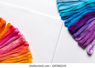 background from multi-colored threads, embroidery floss