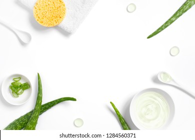 Background with natural cosmetics of aloe vera juice on white, copy space