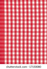 Background from a natural fabric in a red and white cell