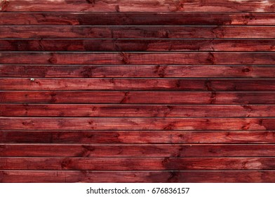 Background of natural knotted wood fence. Wooden texture.