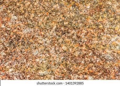 Background of natural stone, granite. Stone patterned background for design. Multicolored granite in natural pattern. Granite texture floor decorative interior. Natural stone texture. High resolution.