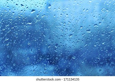 Background with natural water drops on window glass