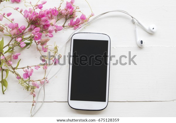 background nature pink flowers  arrange and mobile  on table white