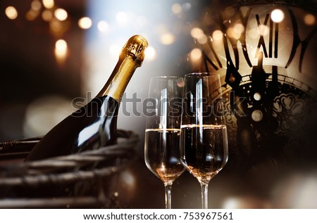 Background for new year congratulations with champagne and a clock