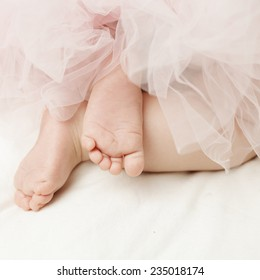 Background for newborn girl with little feet