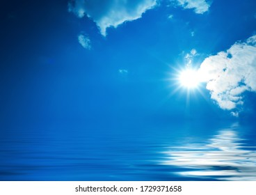 Background of night sea landscape. Night sky, clouds, full moon. Reflection of the moon on the water. Sunset on the sea horizon. Blue tinted blurred background.