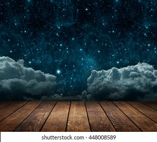 background night sky with stars, moon and clouds. wood floor. Elements of this image furnished by NASA
