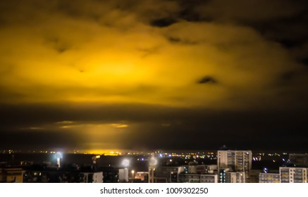 background night yellow light from the city on the sky