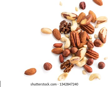 Background of nuts - pecan, macadamia, brazil nut, walnut, almonds, hazelnuts, pistachios, cashews, peanuts, pine nuts.Copy space. Isolated one edge on white with clipping path. Top view or flat lay