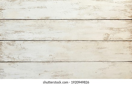 Background of old aged  rough white painted wooden boards close up.