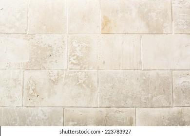 Hintergrund mit alter antiker Ziegelwand. Pastellcreme