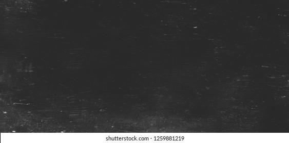 background of old blank black scratched school blackboard