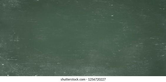 background of old blank green scratched school blackboard