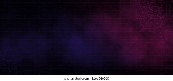 Background of the old brick wall, cracks on the wall, spider web, neon light. Halloween background
