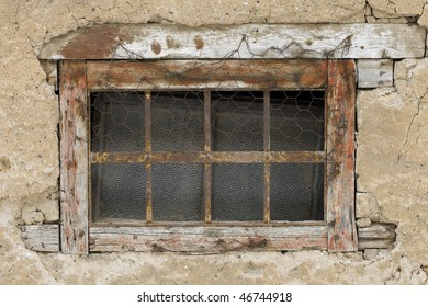 Background old brick wall with window with metal grid