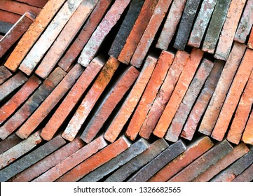 Background of old clay tiles in a pile