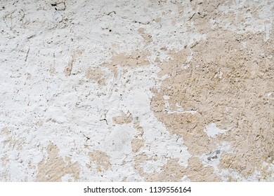 Background of an old cracked white cement wall