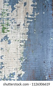 Background of old distressed wood board with peeling paint
