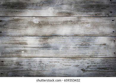 A background of old grey weathered boards.