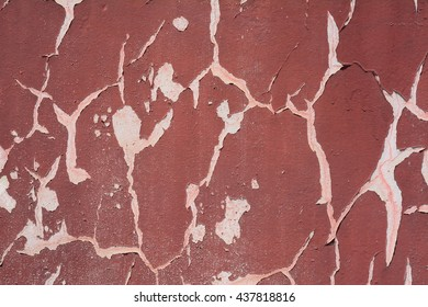 Background of old grungy maroon painted cracked wall texture