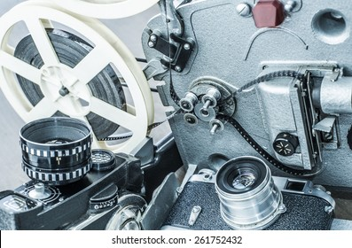 Background of old retro vintage aged art objects movie and metal plastic photo camera with lens a reel of film tape Projector Video analog technical for photography and cinema