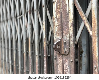 Background: Old rusted iron door.