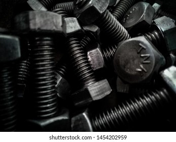 Background from old rusty bolts, nuts, screws, brackets, various metal details