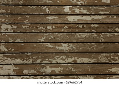 Background of an old shabby wooden background as basis for vintage design. Not standard original creative background of an old wooden shield shielded with cracks and rests of paint. Old wooden floor