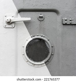 Background of an old ship metal door with a round window