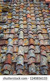 background of an old terracotta tiled roof of a house in the medieval Tuscan village of Casole d'Elsa in the province of Siena, Italy