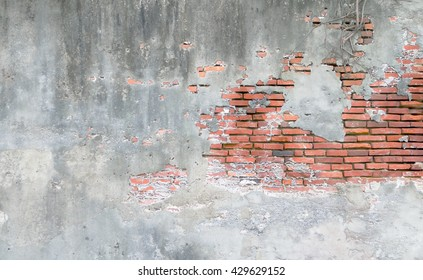 Background of old vintage brick wall with concrete,Weathered texture of racked concrete vintage brick wall background, stained old dark brown and red brick wall background, grungy rusty