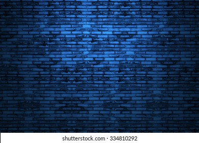 Background of old vintage dark blue brick wall. Street light dark blue brick wall.Blue brick wall. In Tunnel dark blue brick wall. Old school style.