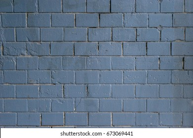 Background of old vintage dark blue brick wall. Street light dark blue brick wall.