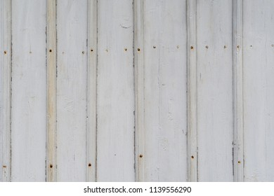Background of an old white wooden wall with rusty nails