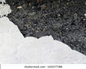 The background of an old whitewashed wall crumbles and inside is visible slag