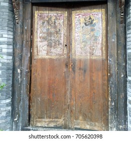 A background of an old wooden door with a peeling off and fading painting at the walking street in Chengdu, China on 18 October 2016