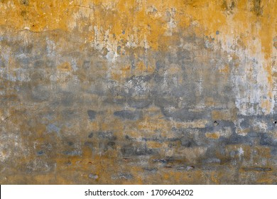 Background of old yellow painted wall, close up texture