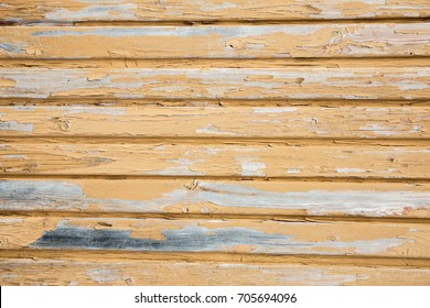 Background of old yellow painted wooden boards